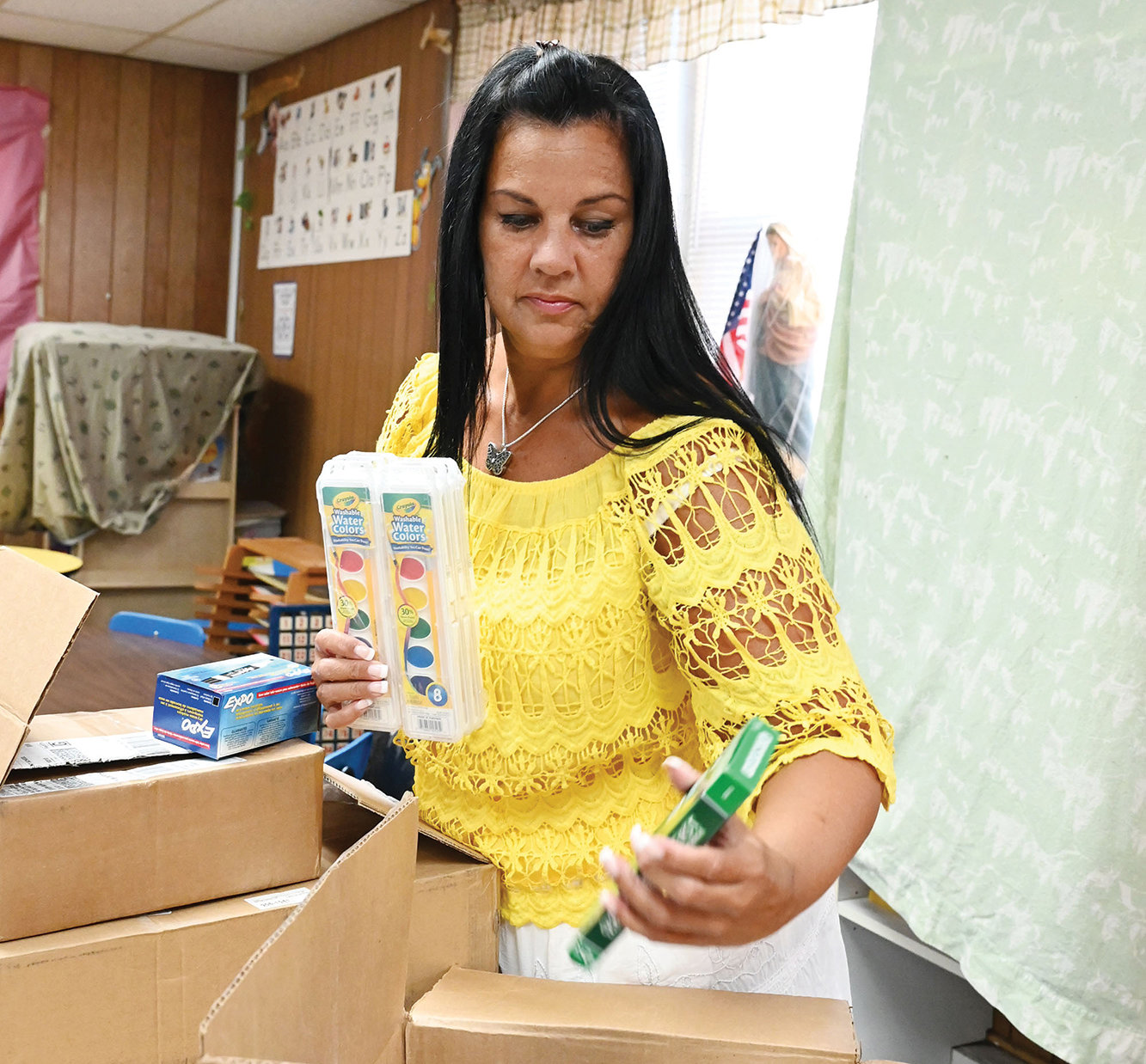 Linda Ballew, a kindergarten teacher at Blessed Sacrament School on Staten Island, unpacks boxes of school supplies as she sets up her classroom for the new school year.