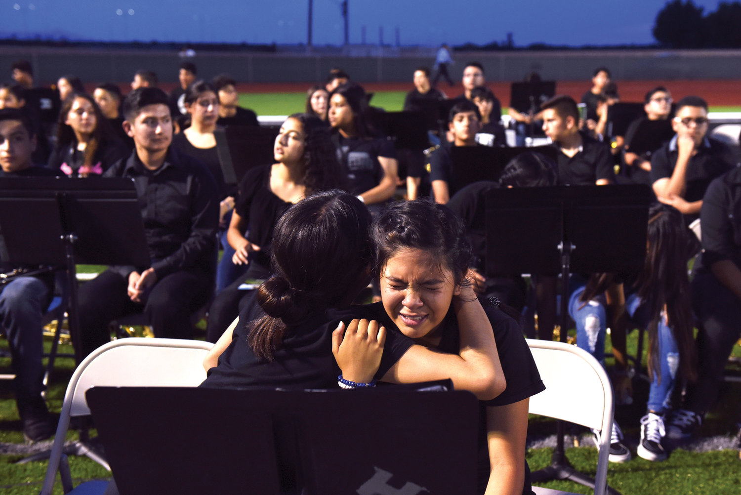 GRIEF—Horizon High School band members embrace after a vigil on Aug. 5 in honor of classmate Javier Rodriguez, who was killed while shopping at a Walmart in El Paso, Texas.