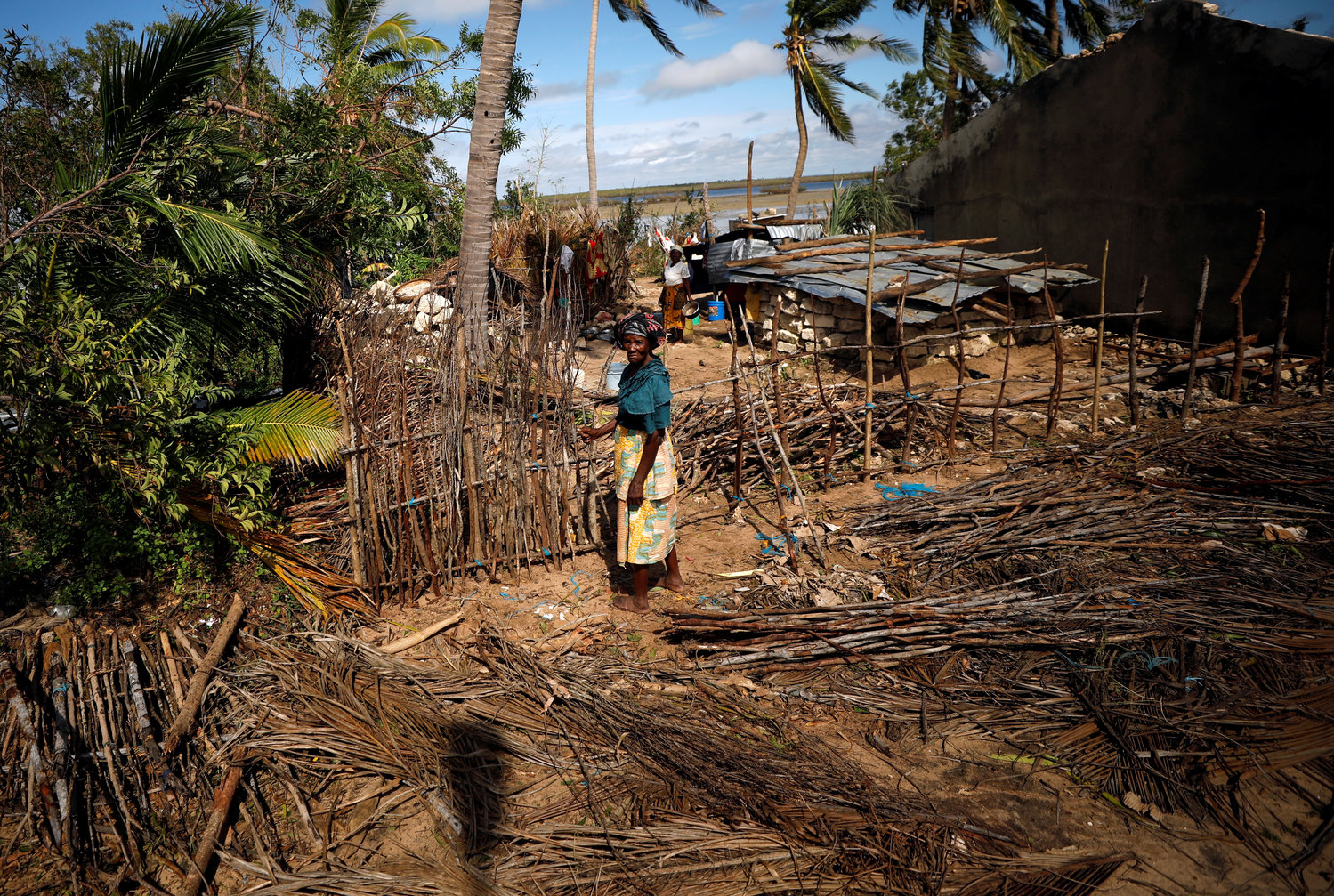 A woman in Ibo, Mozambique, stands outside a house damaged by Cyclone Kenneth May 1. Pope Francis will visit Mozambique on the first leg of a three-nation trip Sept. 4-10 that includes Madagascar and Mauritius.