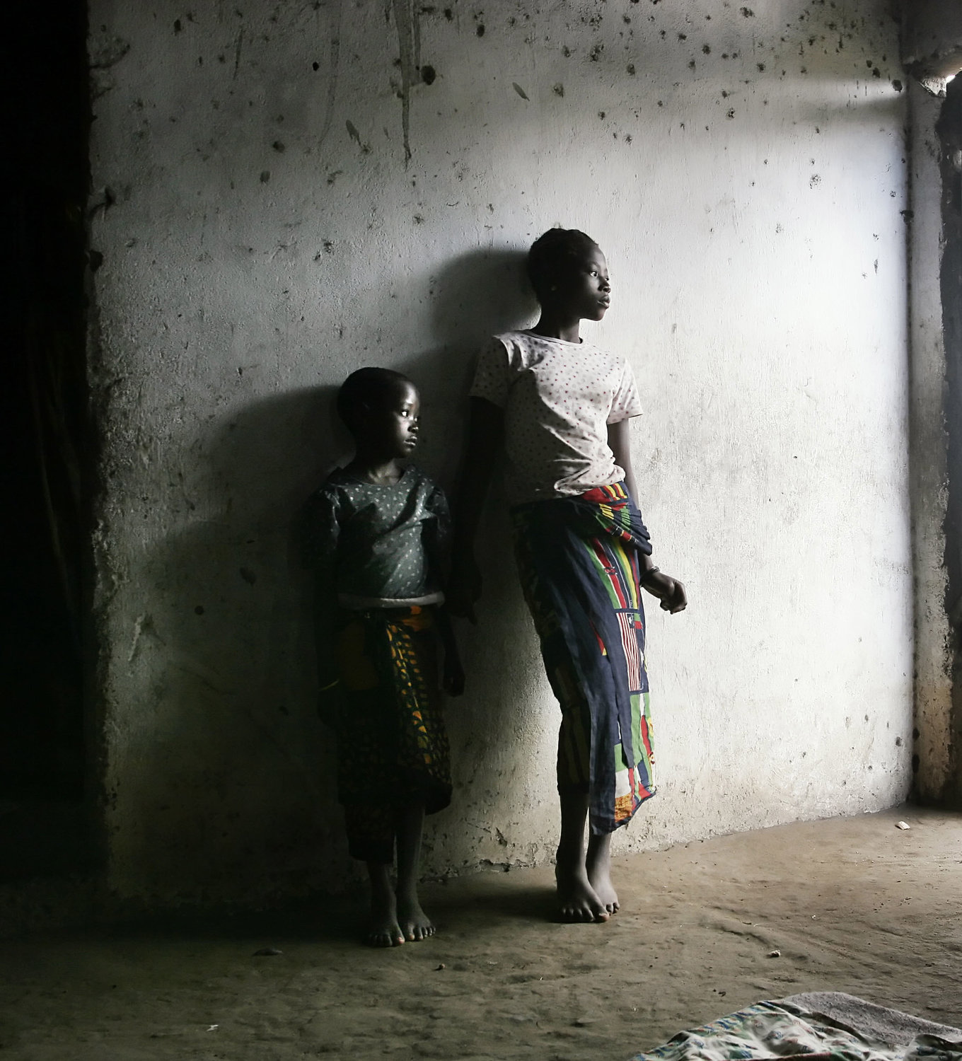Orphaned girls, whose parents died from HIV/AIDS complications, stand inside their home in Tchemulane, Mozambique, in this 2005 file photo. Pope Francis is expected to talk about the health epidemic during a Sept. 4-10 trip to Mozambique, Madagascar and Mauritius.