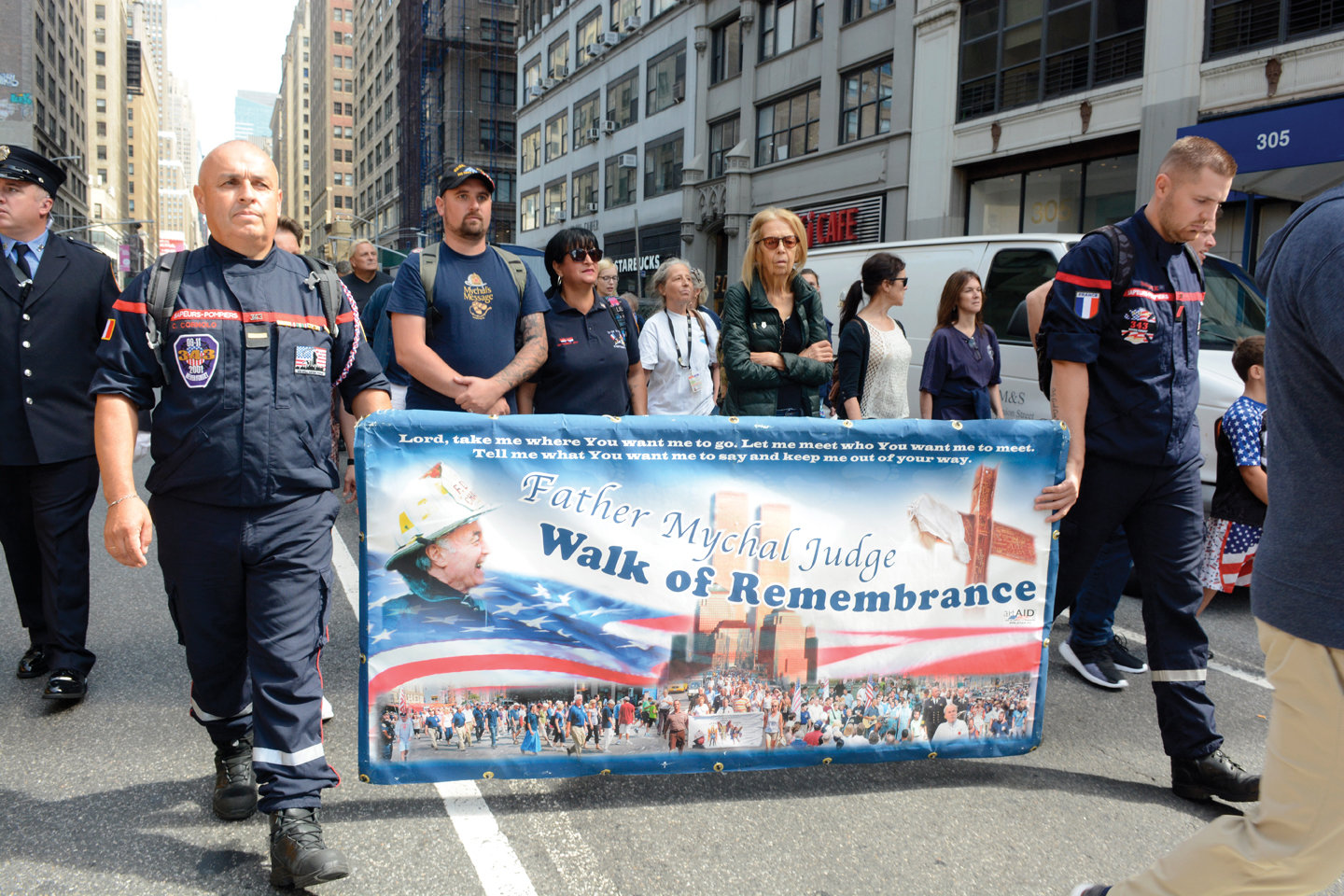 "People participate in the ""Father Mychal Judge 9/11 Walk of Remembrance"" on Sept. 8 in Manhattan, in honor of those lost on Sept.11, 2001. The annual walk retraces the footsteps of Father Mychal Judge, O.F.M., a FDNY chaplain who perished while responding at the World Trade Center on 9/11."