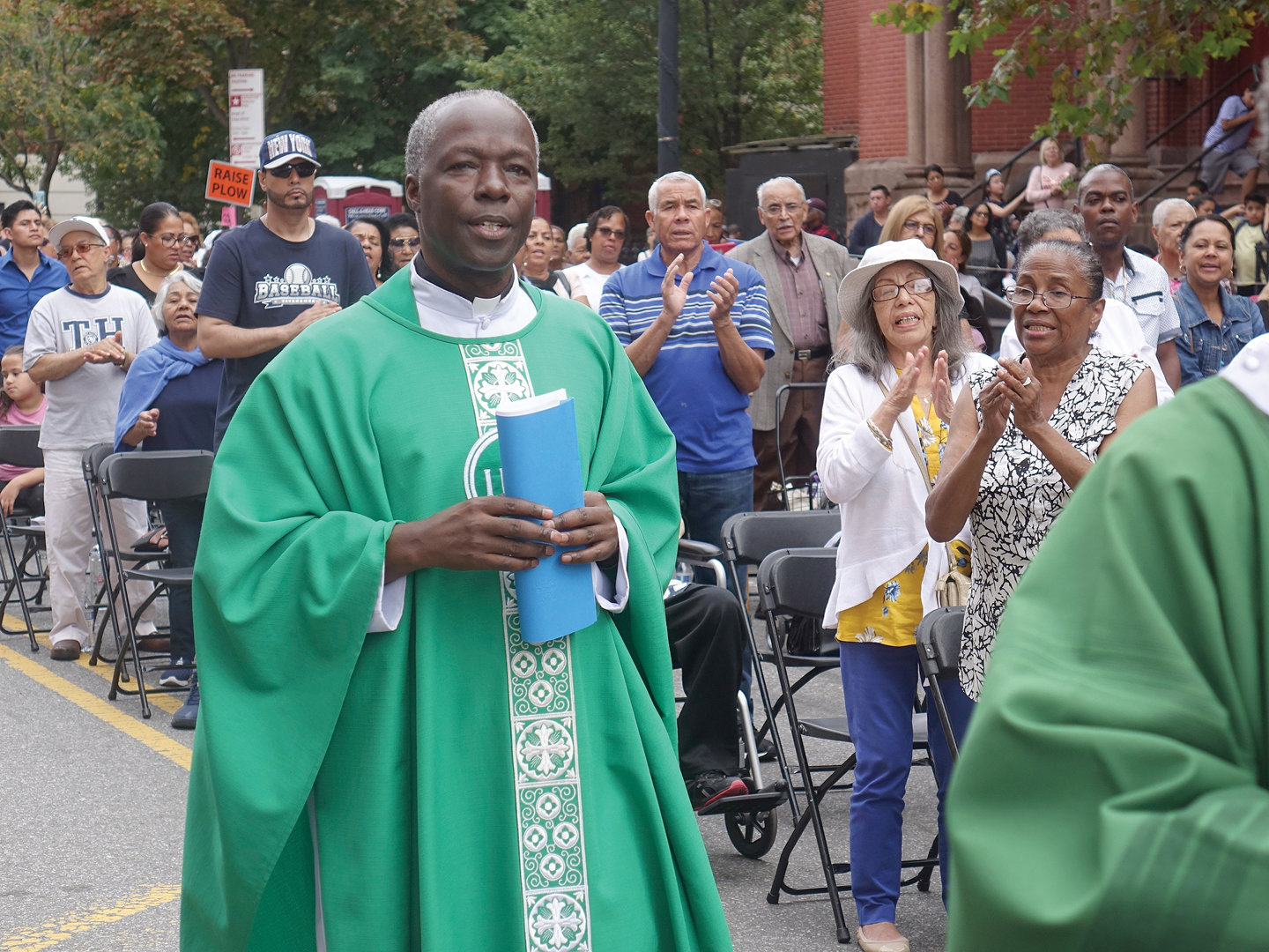 Father Peter Mushi, A.J., pastor, served as the principal celebrant for St. Cecilia and Holy Agony's annual Street Mass on 106th Street between Park and Lexington avenues in East Harlem Sept. 8.