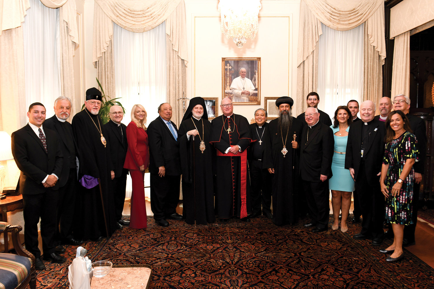 A large group of religious leaders and other representatives gather around Archbishop Elpidophoros and Cardinal Dolan. Next to the cardinal are Archbishop Auza, Bishop David of the Coptic Orthodox Diocese of New York and New England and retired Bishop William Murphy of the Diocese of Rockville Centre. Fourth from the left is Auxiliary Bishop James Massa of the Diocese of Brooklyn and fourth from the right is Father Brian McWeeney, director of ecumenical and interreligious affairs for the archdiocese.