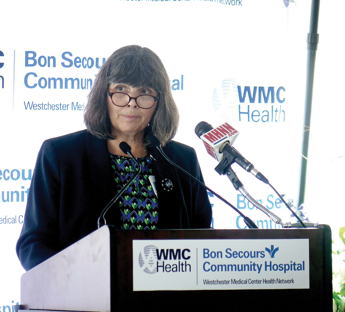 Dr. Mary Leahy, CEO of Bon Secours Charity Health System, addresses attendees at a gathering on the hospital grounds after the cardinal's blessing and dedication.