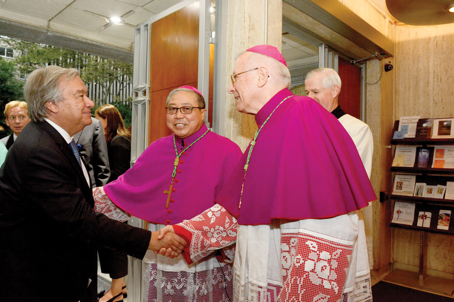 António Guterres, Secretary-General of the United Nations, greets Bishop Paul Hinder, O.F.M. Cap., apostolic vicar of Southern Arabia, right, and Archbishop Bernardito Auza, apostolic nuncio, permanent observer of the Holy See to the United Nations, middle, before the Sept. 16 Prayer Service on the Vigil of the Opening of the 74th Session of the United Nations General Assembly at Holy Family Church in Manhattan. Behind them is Father Gerald Murray, pastor of Holy Family.