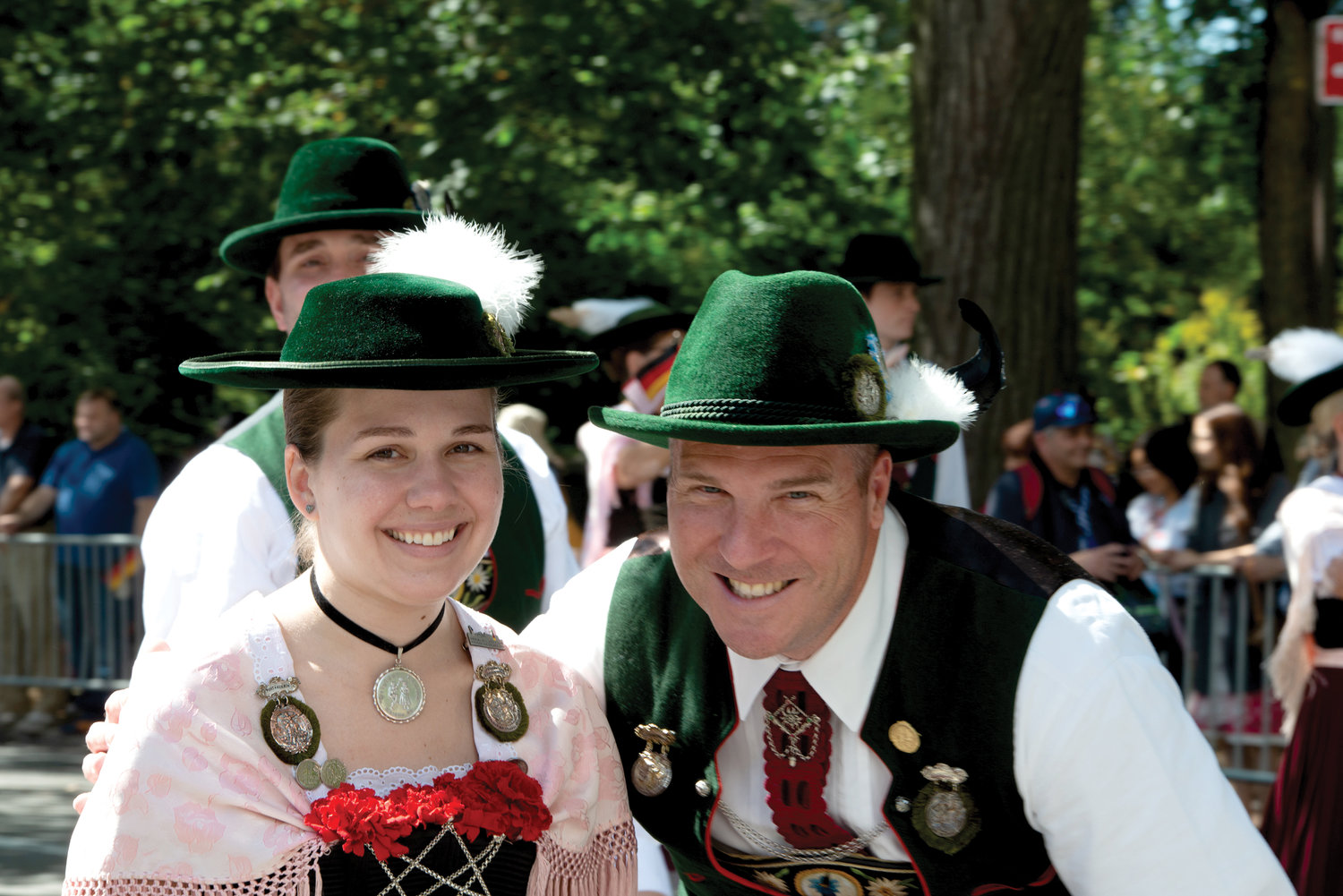 Christina Rom and Tom Schneider of the German folk-dancing group, S.V.V. Original Enzian, march up Fifth Avenue in Manhattan at the 62nd annual German-American Steuben Parade New York Sept. 21.