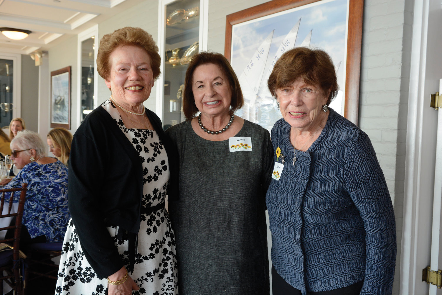 Honorees Ginny Quinn, Valerie Mastronardi and Maureen Morris gather for a group photo.
