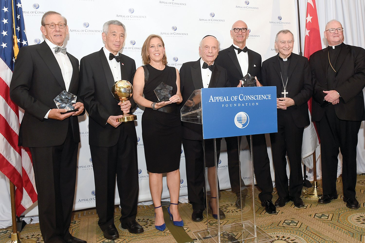 Cardinal Dolan, right, and Cardinal Pietro Parolin, Vatican secretary of state, second from right, look on as Rabbi Arthur Schneier, president and founder of the Appeal of Conscience Foundation, center, presents the 2019 World Statesman Award to Lee Hsien Loong, prime minister of Singapore, second from left, at the annual Appeal of Conscience Awards Dinner Sept. 23 at the Pierre Hotel in Manhattan. The 2019 Appeal of Conscience Awards were presented to, from left, Stephen Ross, chairman and founder of Related Companies; Susan Wojcicki, CEO of YouTube; and Timotheus Höttges, CEO of Deutsche Telekom AG. Cardinal Dolan offered the invocation and Cardinal Parolin delivered greetings from Pope Francis. The Appeal of Conscience Foundation, headquartered in Manhattan, is an interfaith organization dedicated to religious freedom and human rights.