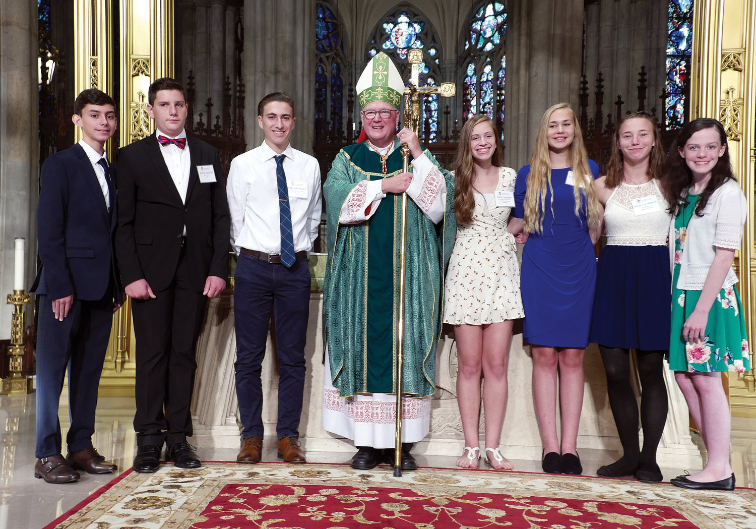 Cardinal Dolan greets the members of the Archdiocesan Youth Team after Mass at St. Patrick's Cathedral Sept. 22. The cardinal commissioned and blessed the team members. Standing from left are Giovanni Anthony Gauzza, Daniel Velardo, Adam Andreani, Cardinal Dolan, Faith Jackson, Katie Westin, Veronica Keene and Natalie Varker.