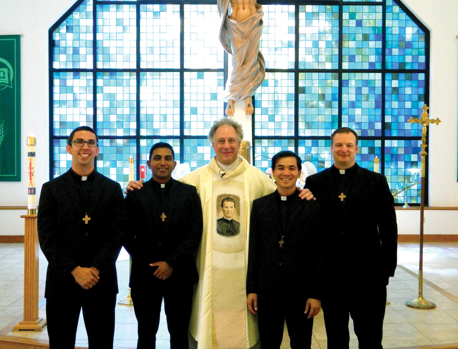Father Timothy Zak, S.D.B., Salesians of Don Bosco provincial of the Province of Canada and the eastern United States, joins the four Salesians who professed final vows Aug. 17. They are, from left, Brother Leonard Carlino, S.D.B., left, Brother Sasika Lokutettige, S.D.B., Brother Ky Nguyen, S.D.B., and Brother Craig Spence, S.D.B.