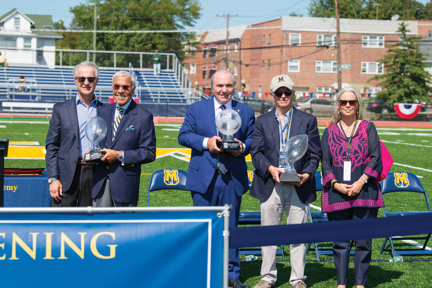 Below, School President Peter Corritori Jr., '71, left, stands with the earliest supporters of the project, Mozilo, second from left; Commisso, center; and Buzz Zaino '61 and Allison Zaino, right.