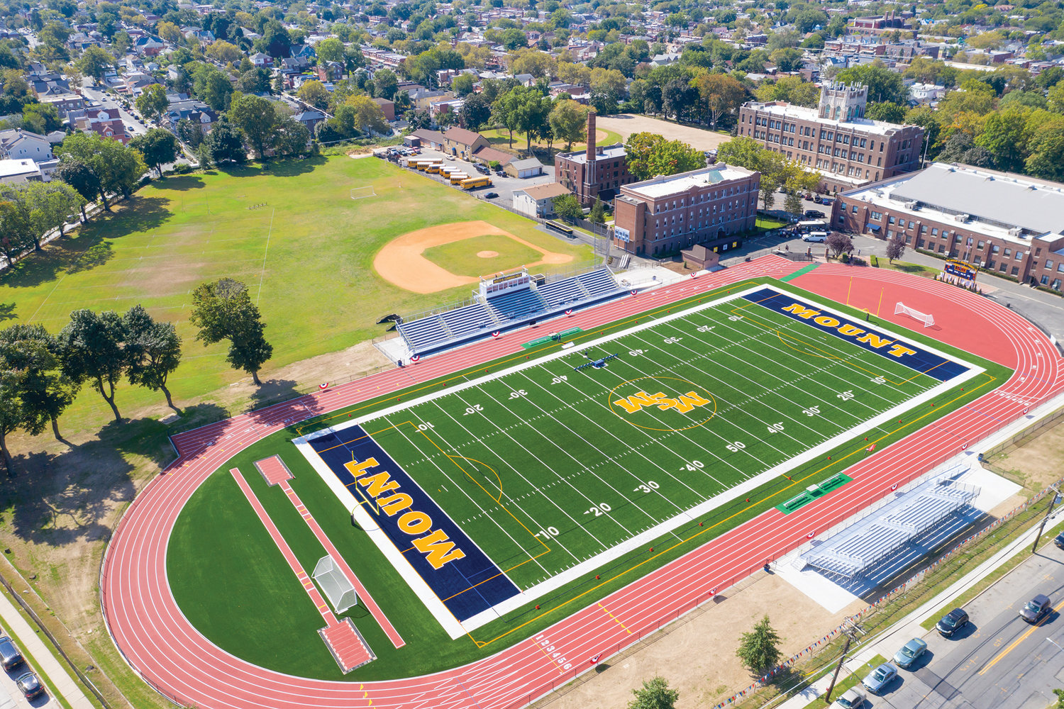 An aerial view of the new Phyllis and Angelo Mozilo '56 Sports Complex at Mount St. Michael Academy in the Bronx. The official opening came Sept. 21 at the football home opener, a 21-8 loss to Holy Cross High School of Queens. The complex includes the Vincent Promuto '56 Stadium, the Brother Linus Carroll, F.M.S., Track and the Rocco B. Commisso '67 Field. The project cost $3 million.