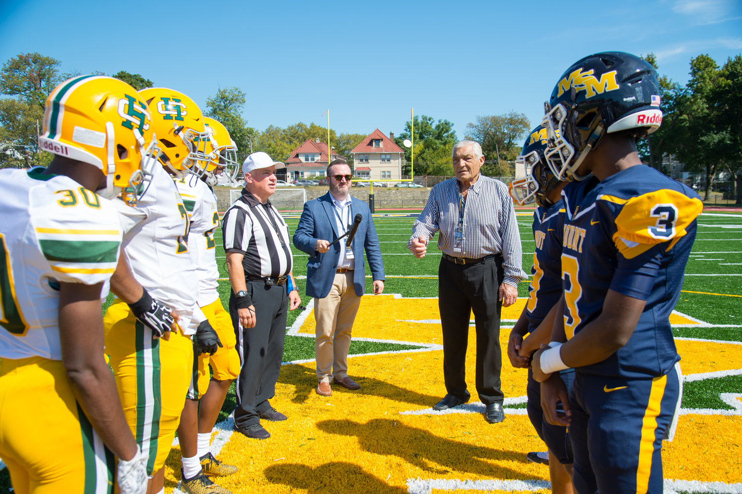 Vince Promunto tosses the coin before Mount St. Michael Academy played Holy Cross in the Bronx Sept. 21.