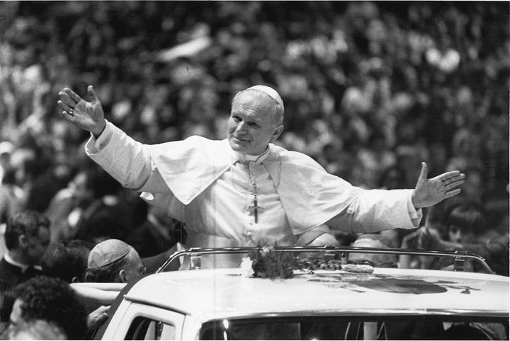 NEW YORK MOMENT—Pope John Paul II opens his arms wide at the youth rally in Madison Square Garden during his October 1979 visit to New York.