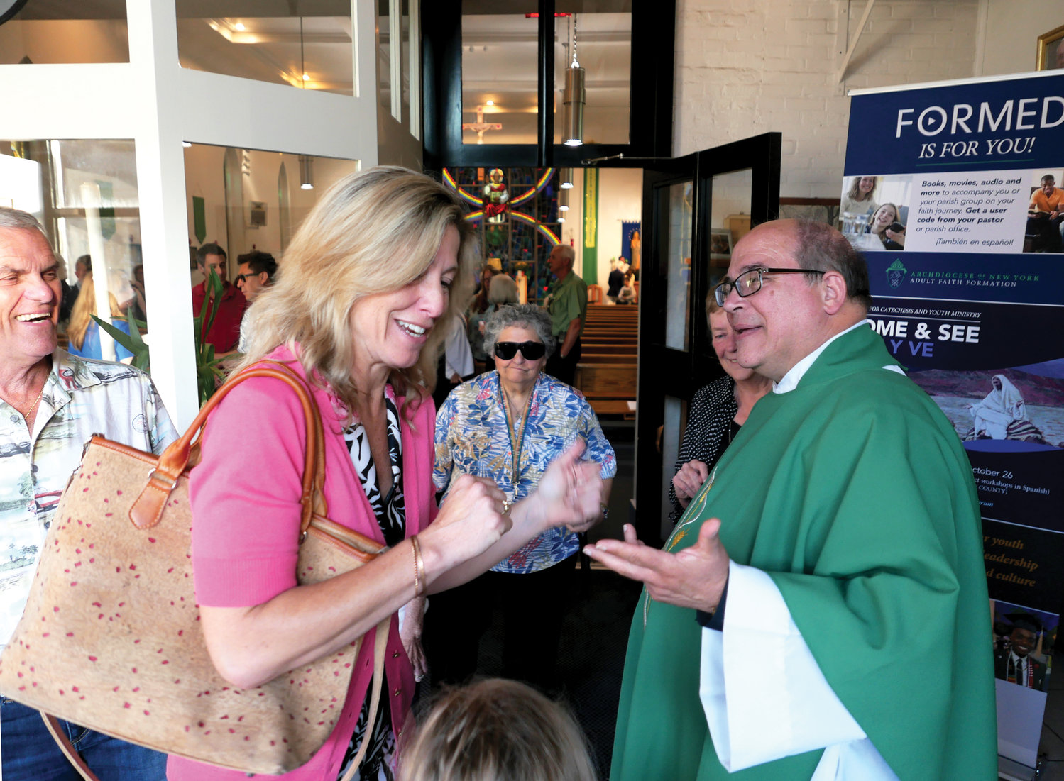 Father Mike Palazzo, pastor, greets parishioners after Cardinal Dolan's Mass celebrating the 50th anniversary of Holy Name of Jesus parish in Otisville Sept. 21.