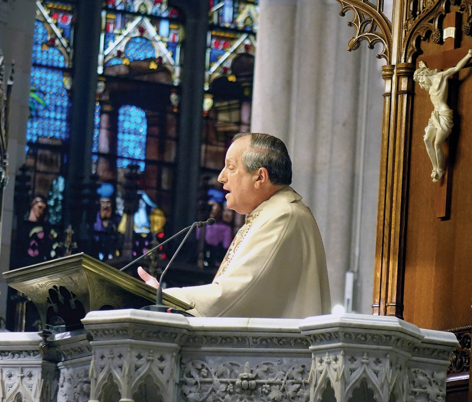 Msgr. Thomas Sandi, pastor of Holy Trinity parish in Manhattan and regional dean for West Manhattan, delivers the homily.