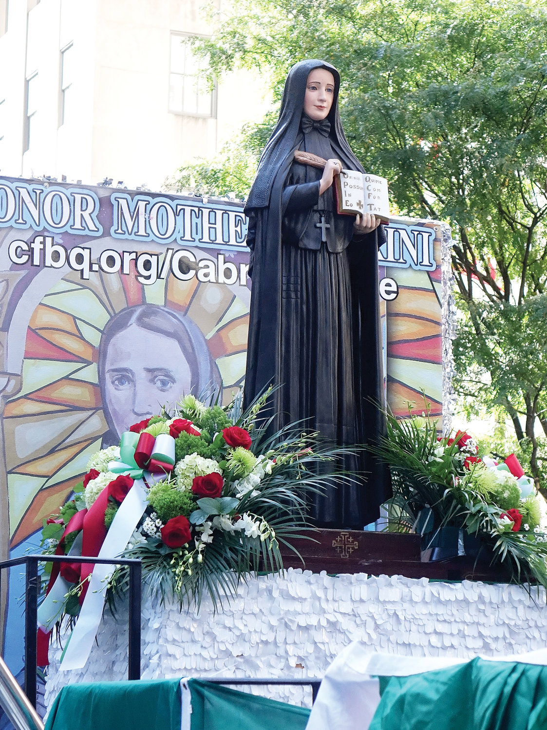 A statue of St. Frances Xavier Cabrini stands on a float in the parade up Fifth Avenue.