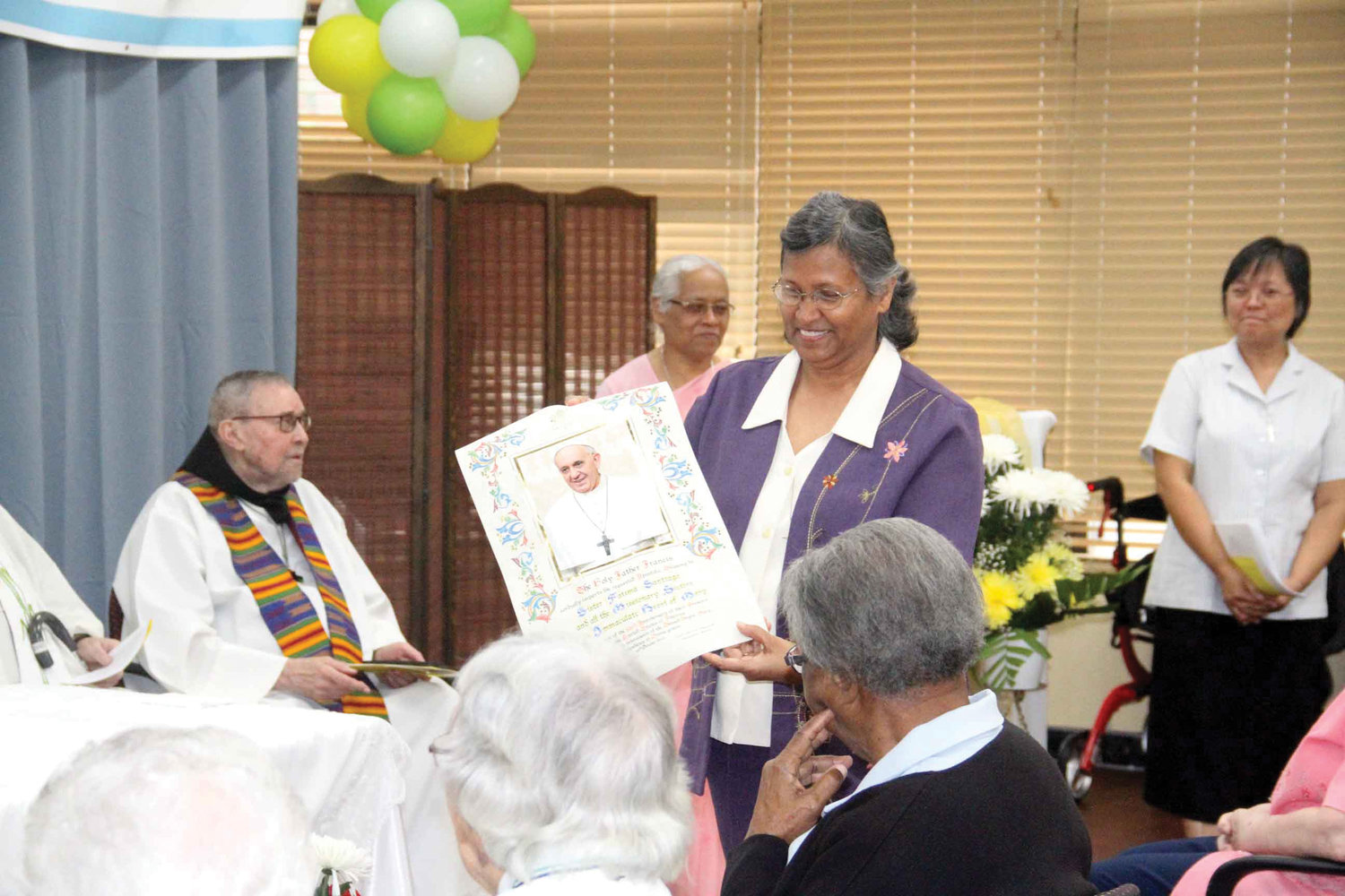 Sister Fatima Santiago, I.C.M., U.S. mission superior, holds a blessing from Pope Francis as the Missionary Sisters of the Immaculate Heart of Mary celebrated 100 years in the United States and New York at Kittay Senior Apartments in the Bronx Oct. 10.