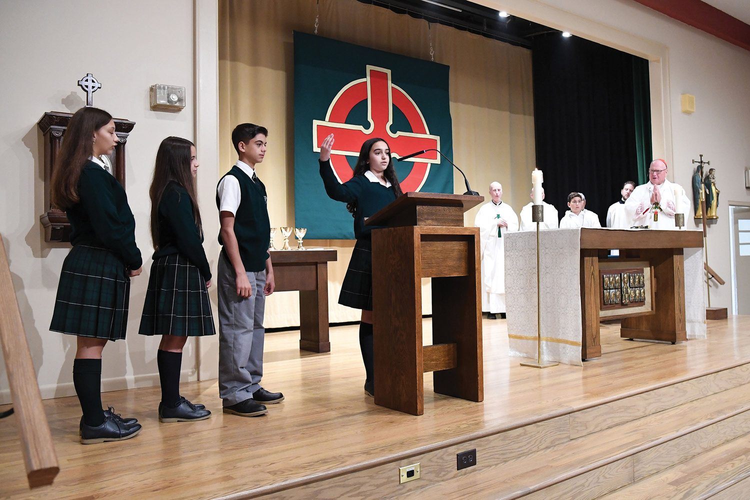 Students from St. Patrick's School on Staten Island present the Prayer of the Faithful at the Oct. 12 vigil Mass Cardinal Dolan offered to mark the school's centennial.