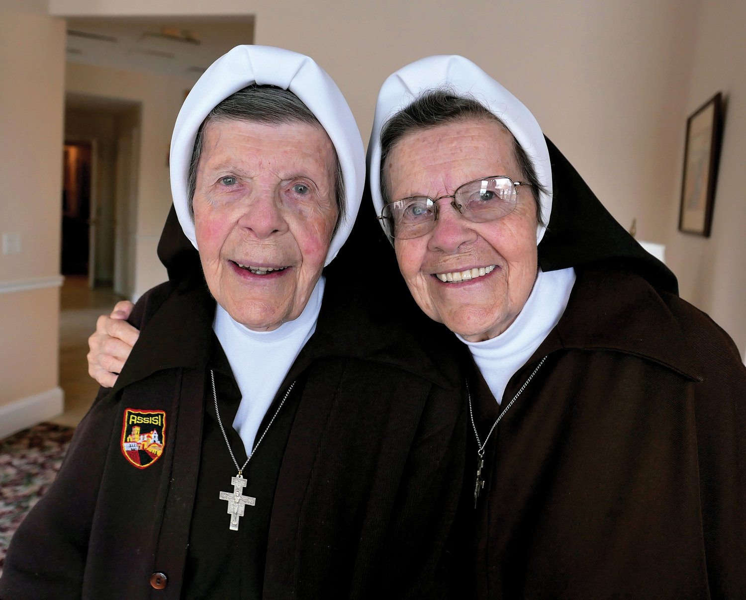 Sister Mary Robert Bernet, O.S.F., left, and her twin sister, Sister Mary Clare Bernet, O.S.F., share a smile last week in their convent in Peekskill. Both are Sisters of St. Francis of the Neumann Communities. The retired longtime teachers are celebrating 70 years of religious life.
