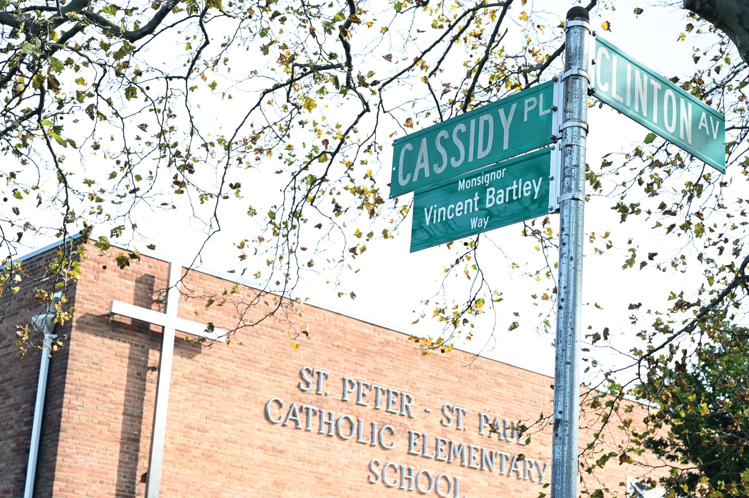 A street sign dedicated to the late Msgr. Vincent Bartley, a longtime pastor of St. Paul parish on Staten Island, was unveiled Oct. 26 in front of St. Peter-St. Paul School, at the corner of Cassidy Place and Clinton Avenue, Staten Island.