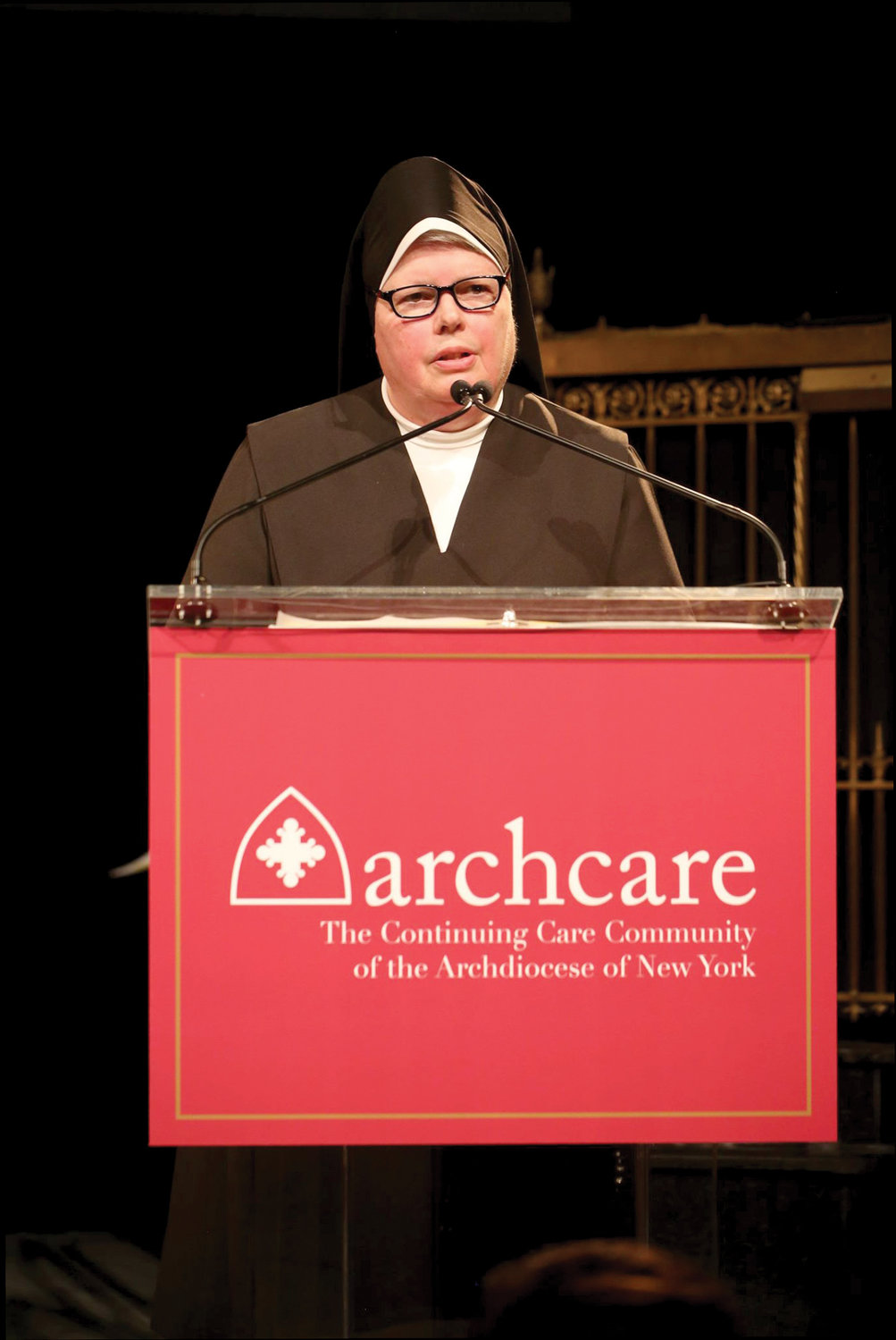 Mother M. Mark Louis Randall, O. Carm., prioress general of the Carmelite Sisters for the Aged and Infirm, delivers the invocation. Sister Sean William O'Brien, O. Carm., who served as executive director of ArchCare at Mary Manning Walsh Home in Manhattan until her death July 22, received a Memorial Tribute.