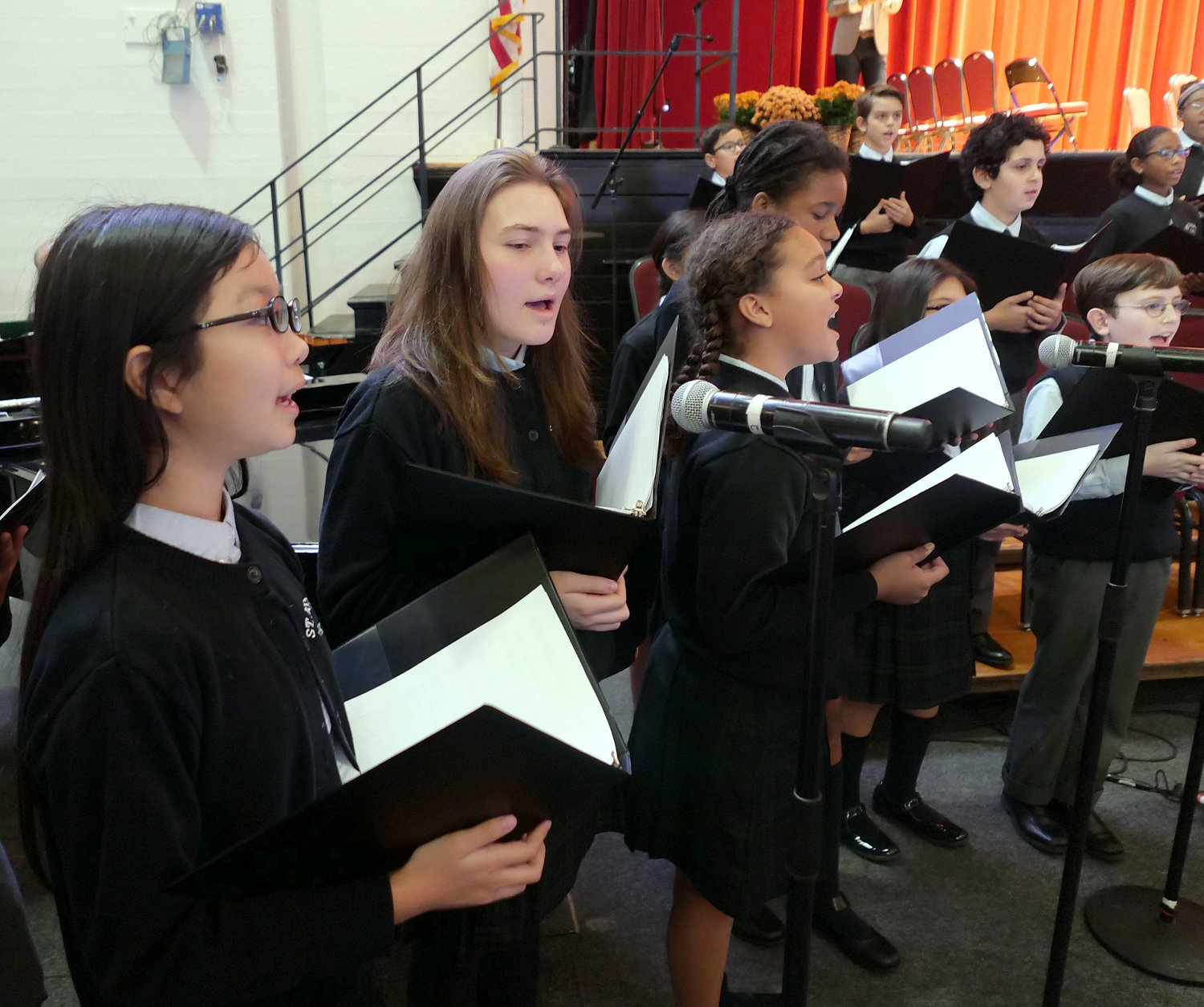The student choir from St. Joseph's School, Yorkville, sings during the Mass. Bridget Hogan is the choir director.