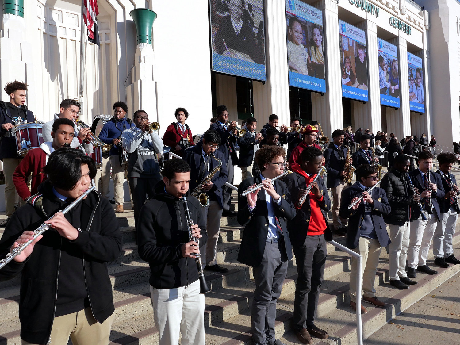 The band from Cardinal Hayes High School in the Bronx provides a musical welcome outside Westchester County Center.