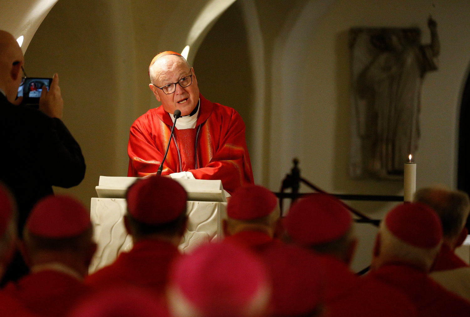 "Cardinal Dolan delivers the homily as U.S. bishops from the state of New York concelebrate Mass in the crypt of St. Peter's Basilica at the Vatican Nov. 14. The bishops were making their ""ad limina"" visits to the Vatican to report on the status of their dioceses to the pope and Vatican officials."