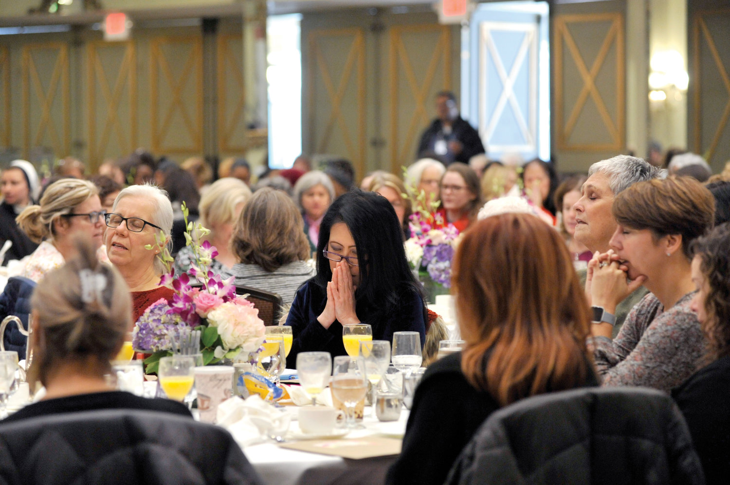 Women join in prayer at the Feminine Genius Brunch at Hilton Westchester in Rye Brook Nov. 16. There were 350 women representing 130 parishes at the brunch sponsored by the archdiocesan Respect Life Office.