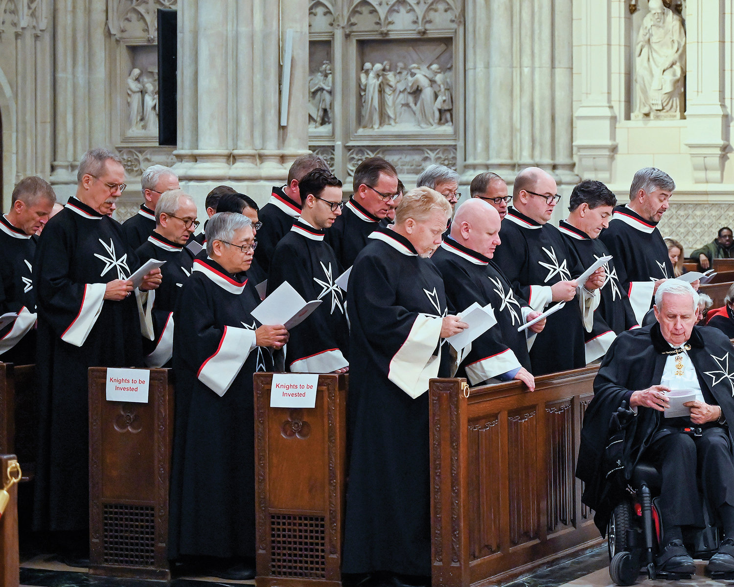 Men to be invested as knights in the Order of Malta stand as their names are called during the Mass and Investiture ceremony Nov. 15 at St. Patrick's Cathedral.