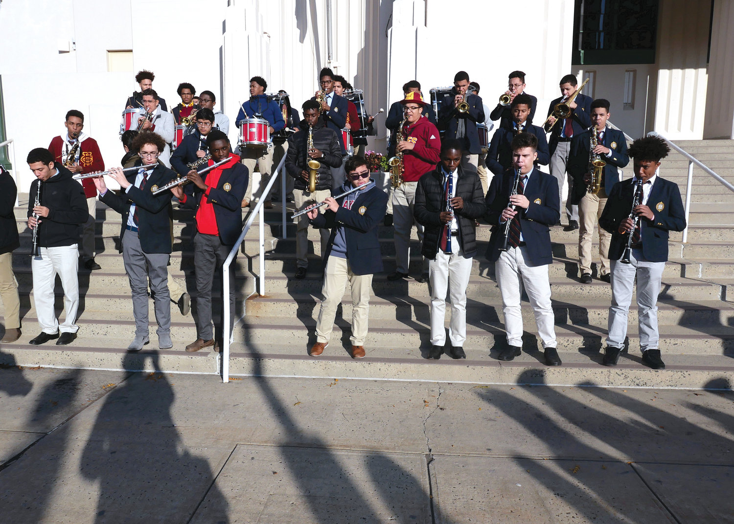The band from Cardinal Hayes High School in the Bronx serenades arriving participants.