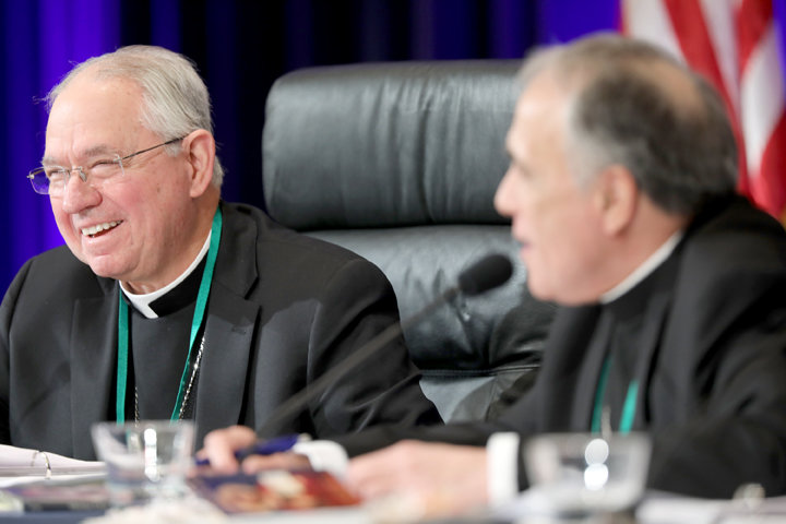 Archbishop Jose H. Gomez of Los Angeles, president-elect of the U.S. Conference of Catholic Bishops, and outgoing president, Cardinal Daniel N. DiNardo of Galveston-Houston, smile during the fall general assembly of the USCCB in Baltimore Nov. 13, 2019. (CNS photo/Bob Roller) See BISHOPS-OFFICERS-COMMITTEES Nov. 12, 2019.