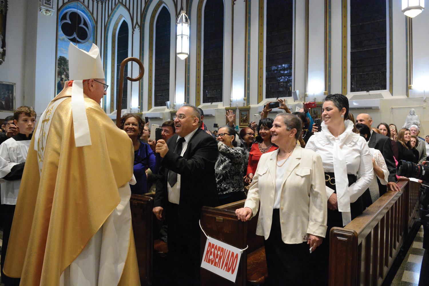 Cardinal Dolan greets parishioners Nov. 2 before celebrating the 150th anniversary Mass at St. Elizabeth Church in the Washington Heights section of Manhattan.
