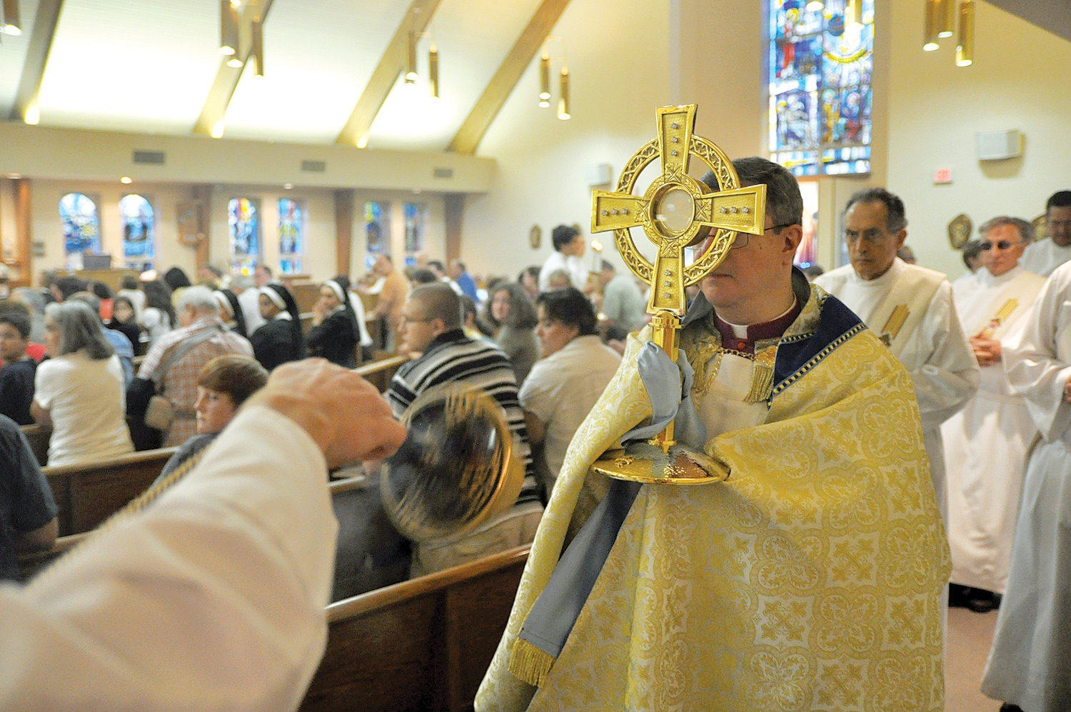Bishop-elect Gerardo Colacicco, then pastor of St. Columba parish in Hopewell Junction, carries the Blessed Sacrament in a monstrance for the Feast of the Most Holy Body and Blood of Christ (Corpus Christi) in 2010. Members of two parishes in Hopewell Junction, St. Columba and St. Denis, gathered at St. Columba Church. The parishes and others in the archdiocese celebrated the feast with prayerful processions honoring the Blessed Sacrament.