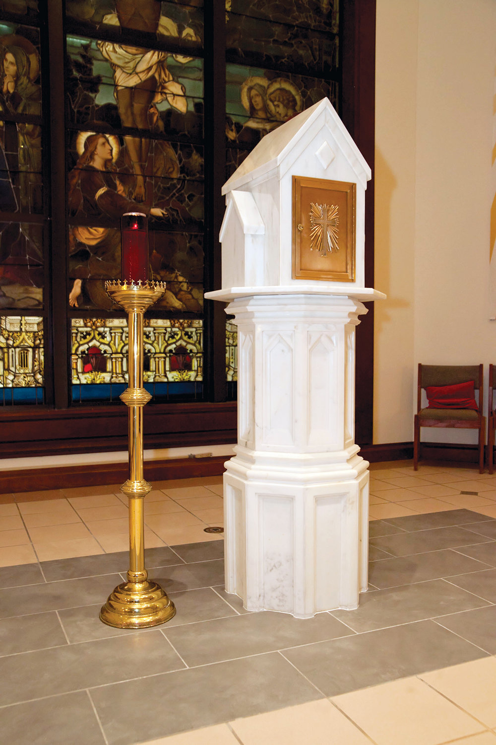 "The tabernacle at Sacred Heart parish in Monroe, right, was transferred recently from the side of the church to the sanctuary behind the altar. Moving the tabernacle served as the Eagle Scout project of parishioner Sean Mende, 17. ""I couldn't be more proud of him and the effort that he put in on this project,"" said Sean's father, Brian Mende."