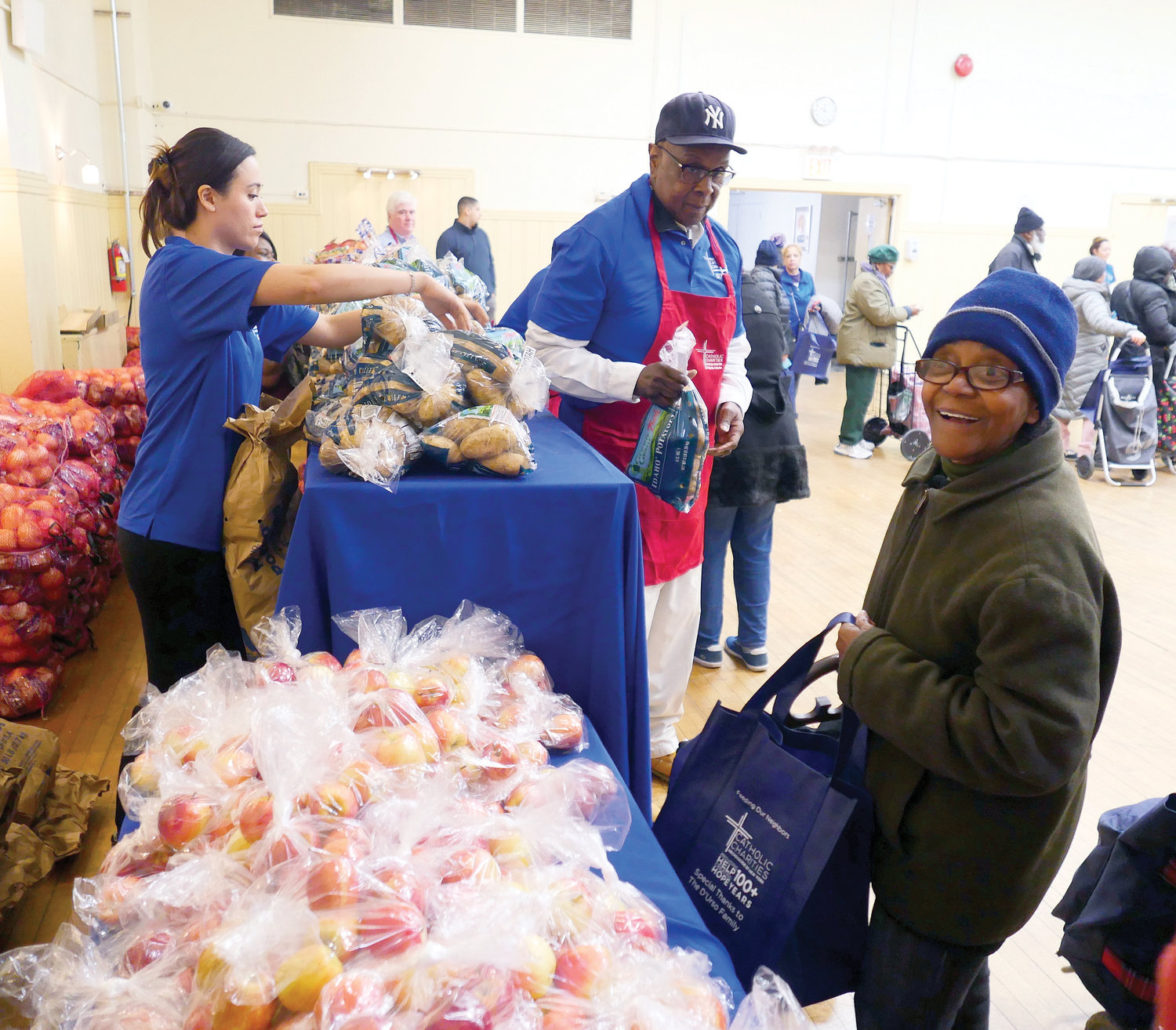 Volunteers and recipients are shown at the community center, located on West 134th Street.