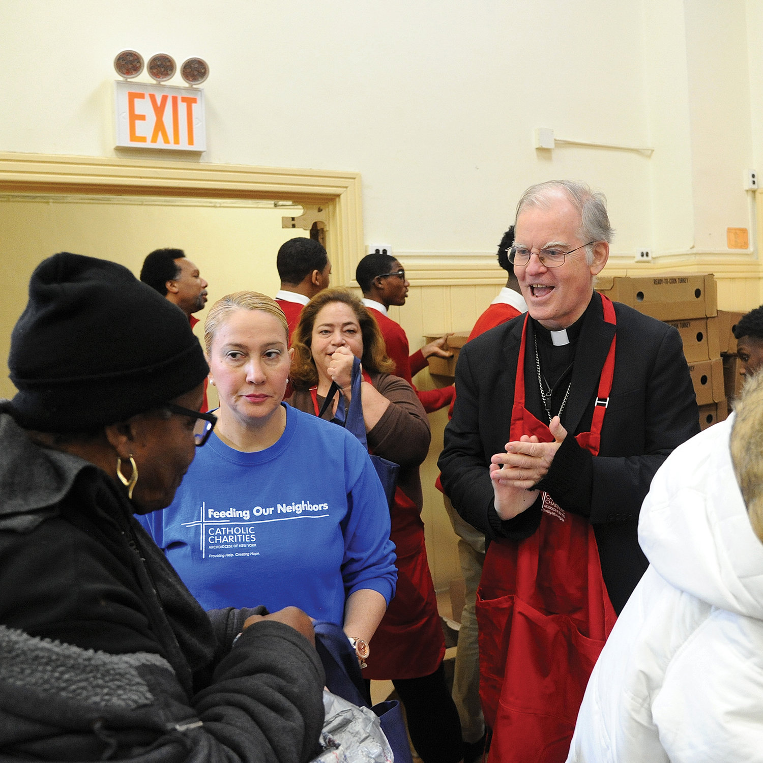 Auxiliary Bishop Peter Byrne led the distribution of 800 Thanksgiving turkeys to families in need two days before Thanksgiving Nov. 26 at the Lt. Joseph P. Kennedy Community Center in Harlem. (The bishop was substituting for Cardinal Dolan, who was offering a Funeral Mass for Alfred E. Smith IV at St. Patrick's Cathedral.) Yams, potatoes and apples completed the full menu given out at the annual turkey distribution by Catholic Charities of New York.