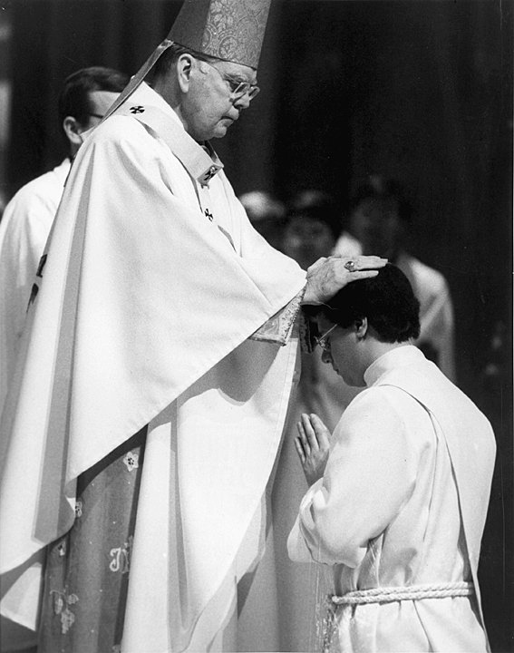 ORDINATION RITES—Cardinal Terence Cooke lays hands on Father Gerardo Colacicco during the Mass at which he was ordained to the priesthood in St. Patrick's Cathedral Nov. 6, 1982.