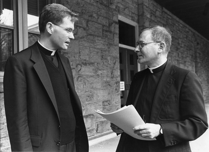 Father Edmund Whalen greets Father Arthur J. Serratelli at a November 1996 conference on the writings of St. Pope John Paul II at St. Joseph's Seminary, Dunwoodie. Now-Bishop Serratelli is the ordinary of the Diocese of Paterson, N.J.