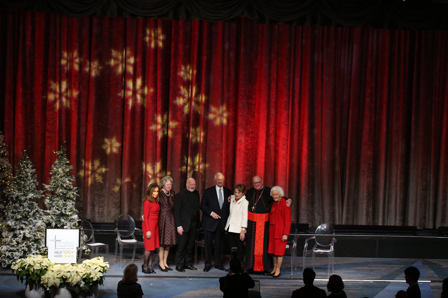 "From left, are ""Good Day New York"" co-host Rosanna Scotto, the emcee; Mary Buckley Teatum, president of the archdiocesan Ladies of Charity; Msgr. Kevin Sullivan, executive director of Catholic Charities; honorees Thomas and Elizabeth Renyi; Cardinal Dolan; and honoree Mary Walsh Cashin."