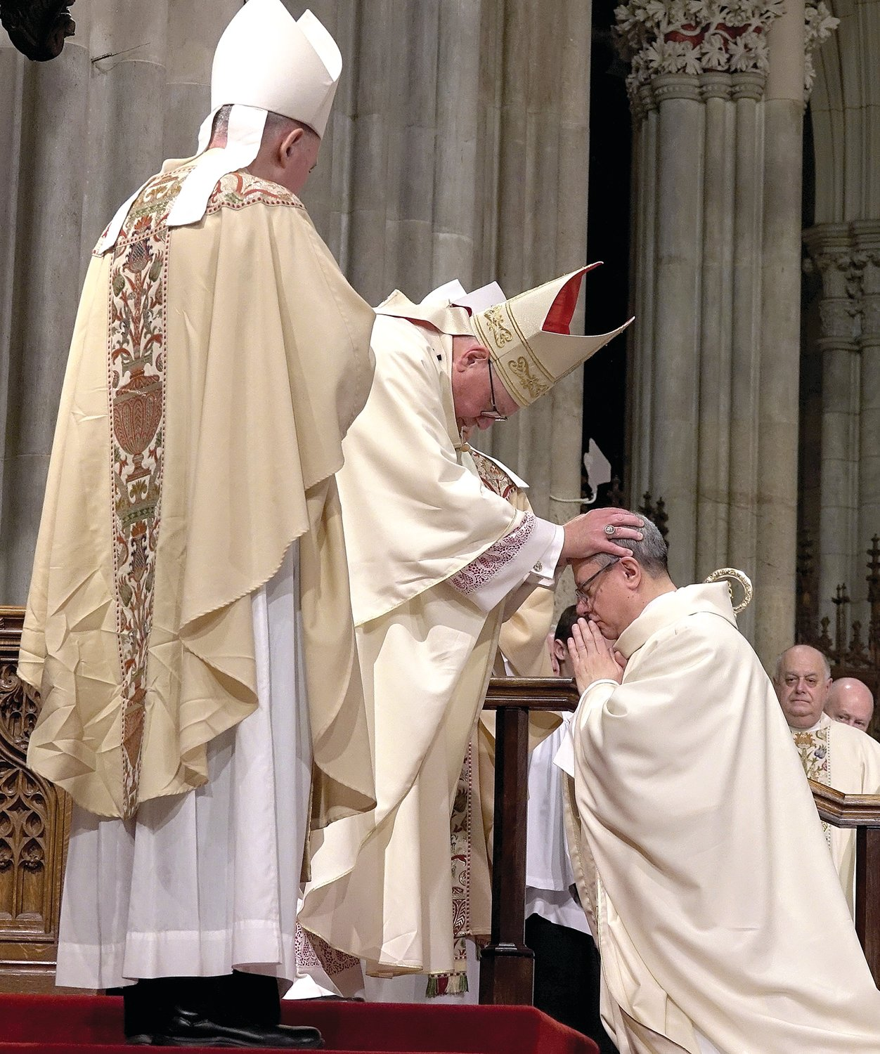 The cardinal lays hands on the head of Auxiliary Bishop Gerardo Colacicco during the rite.