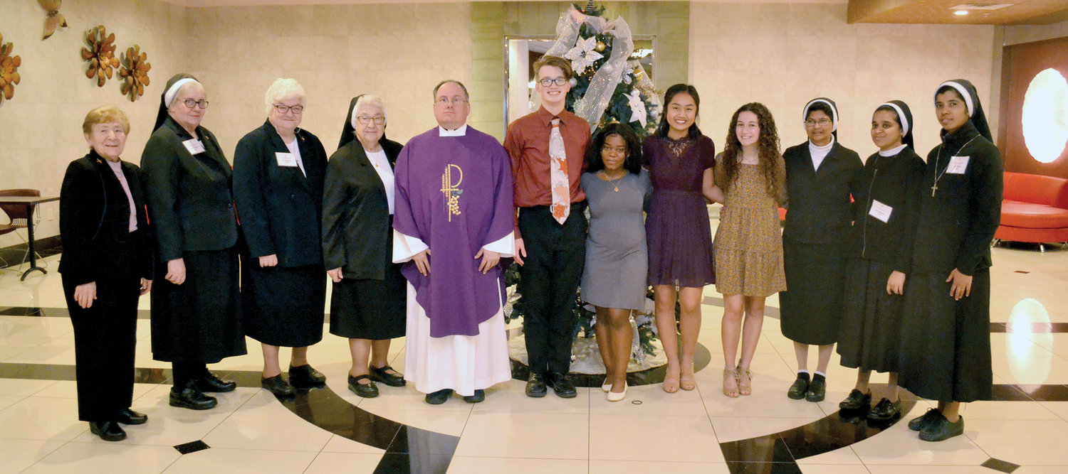 From left, are Sister Carmel Therese Favazzo, C.S.A.C.; Sister Patricia Gatti, C.S.A.C.; Sister Michele Ruggerio, C.S.A.C.; Sister Ann Joachim Fimeno, C.S.A.C., provincial moderator; Father Michael Martine, pastor of Holy Rosary parish on Staten Island, the conference's spiritual moderator; Vice President Michael Spear; Program Chairperson Mytell Jean; President Samantha Schucker; Secretary Daniella Canausa; Sister Shinty Anthony, C.S.A.C.; Sister Smija Peter, C.S.A.C.; and Sister Laveena Bennis, C.S.A.C.