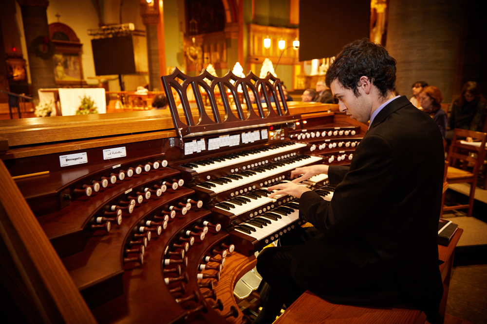 MUSICAL TRIBUTE—Daniel Ficcari, a Julliard alumnus who is the organist at St. Paul the Apostle Church, played two selections from his Visions of the Holy Spirit composition based on the diary writings of Father Isaac Hecker, C.S.P.