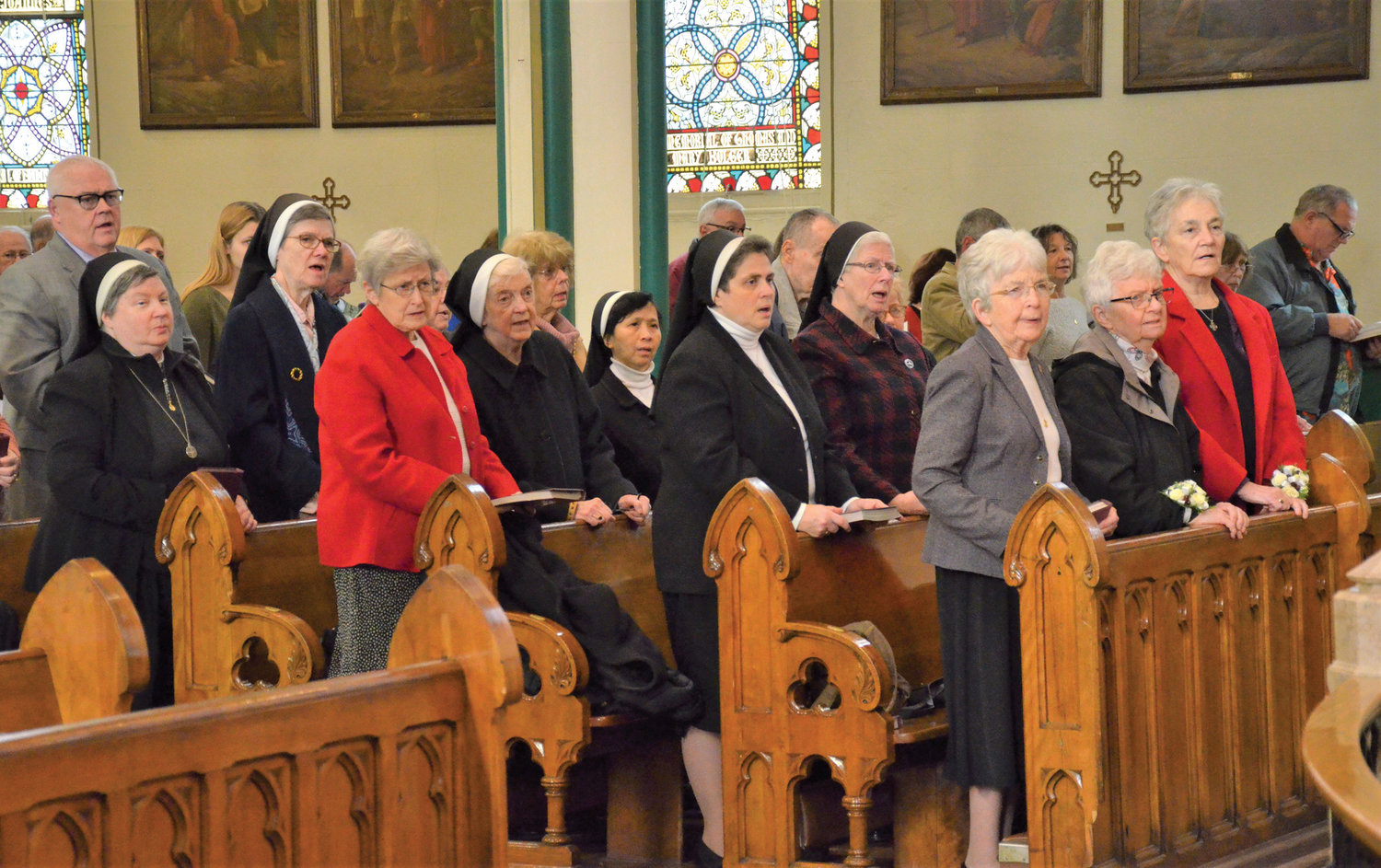 About a dozen Benedictine Sisters of Elizabeth, N.J., attend a Mass at St. Mary's Church in Kingston to show appreciation for the religious order's 118 years of health care service in Kingston.