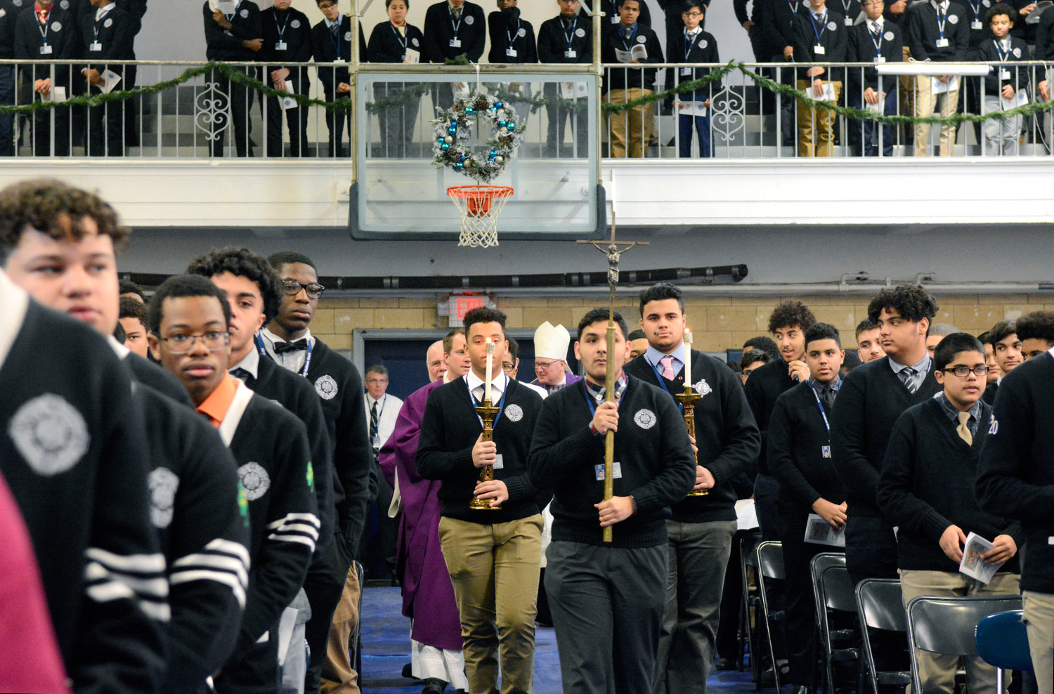 All Hallows High School students participate in the entrance procession during the Dec. 19 Mass Cardinal Dolan offered at the school. The liturgy was part of a mission project conducted that week by Emmanuel School of Mission.