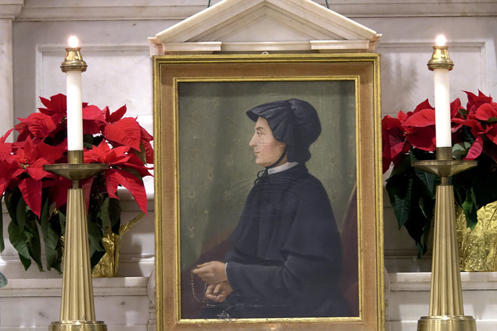 SAINTLY HISTORY—A portrait of St. Elizabeth Ann Seton, founder of the Sisters of Charity, occupies a place of honor in St. Peter's Church on Barclay Street in lower Manhattan during the Jan. 4 Mass offered by Cardinal Dolan to mark the opening of the bicentennial year of her entrance into eternal life. St. Elizabeth Ann Seton entered the Catholic Church at St. Peter's in 1805.