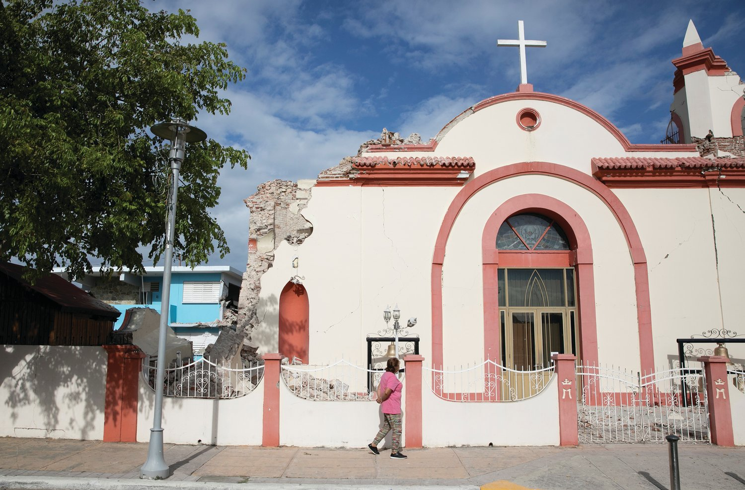 DEVASTATION—A woman in Guayanilla, Puerto Rico, walks in front of the damaged Immaculate Conception Church Jan. 9 after an earthquake struck the area two days earlier.