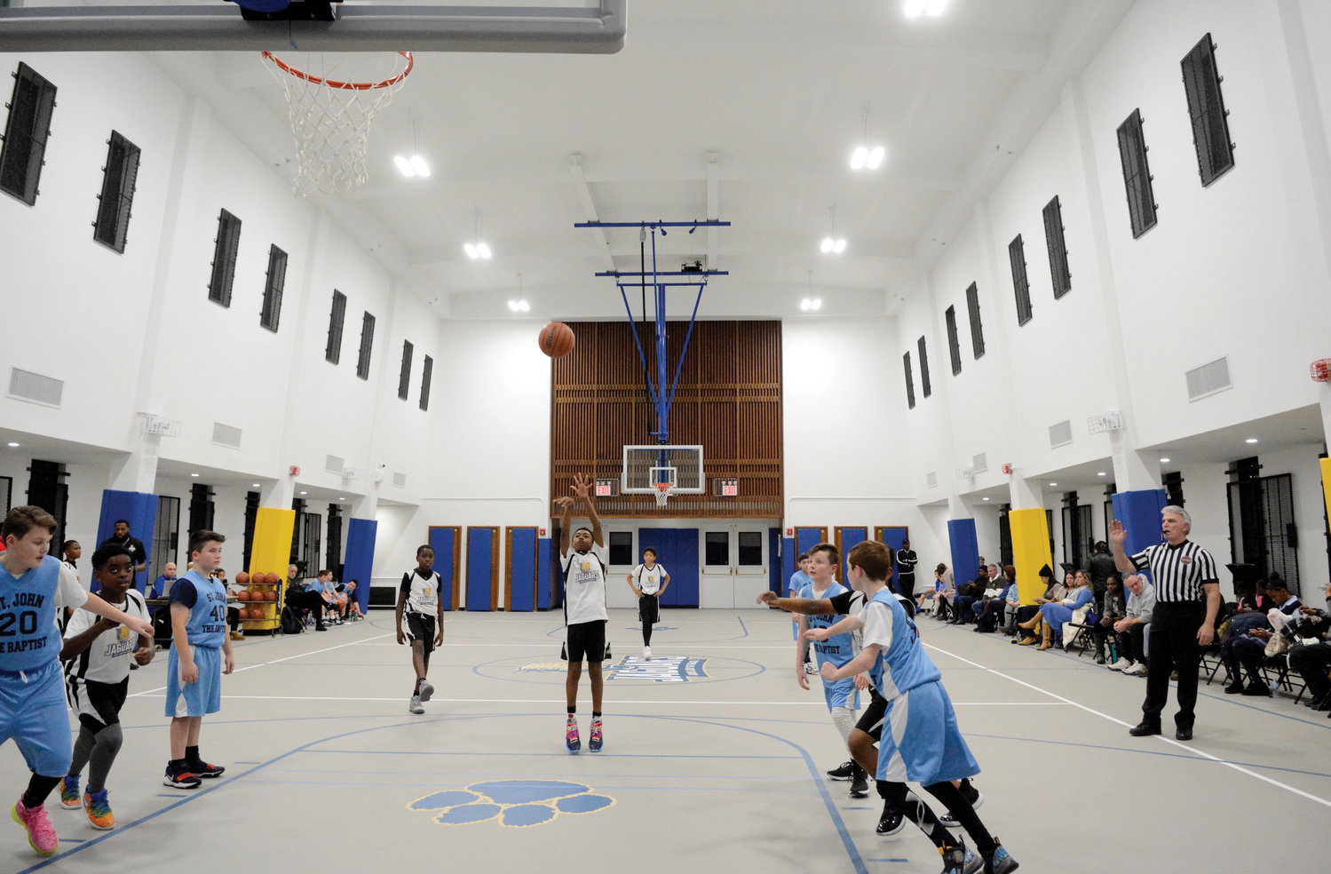 A wide view from one end of the new Our Lady of Grace School gymnasium as a free throw is taken during Our Lady of Grace's game with St. John the Baptist of Yonkers in the Bronx Jan. 8.