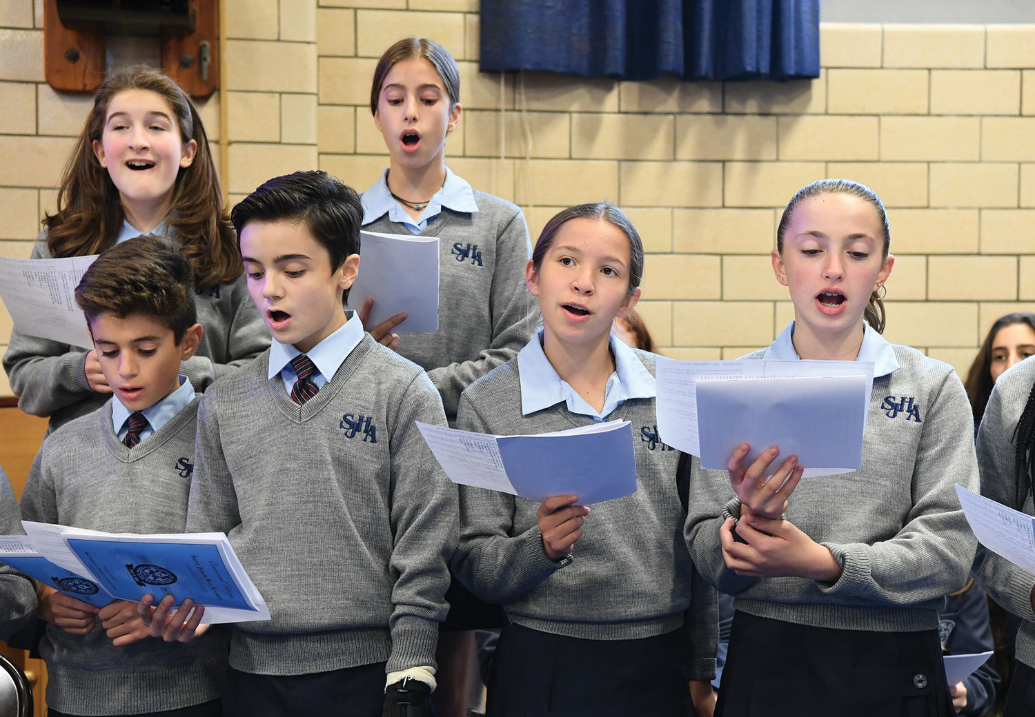 The Hill Centennial Choir of St. Joseph Hill Academy on Staten Island sings before the Vigil Mass Cardinal Dolan offered Oct. 19 in conjunction with the school's centennial year.